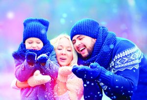 50356780 - portrait of happy family blowing winter snow
