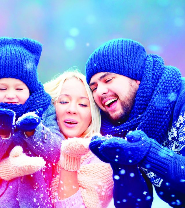 50356780 – portrait of happy family blowing winter snow