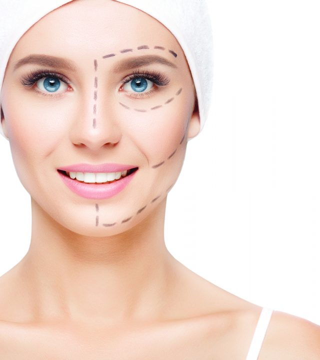 Woman with perforation lines on her face