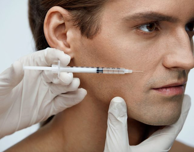 Cosmetology. Handsome Man Getting Filler Injections In Face Skin