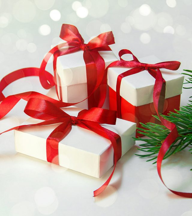 Christmas Gift's in White Box with Red Ribbon on Light Backgroun