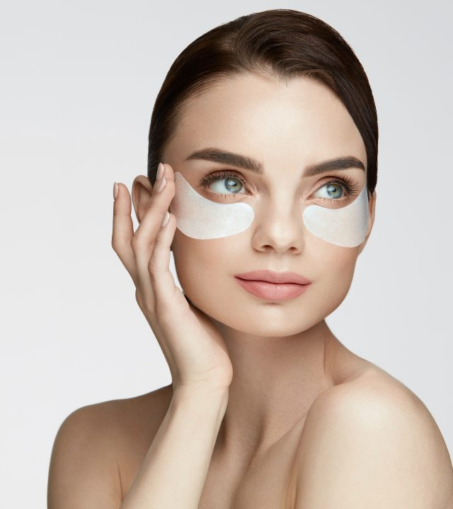 Eye Skin Beauty. Female With Under Eye Care Product On Face